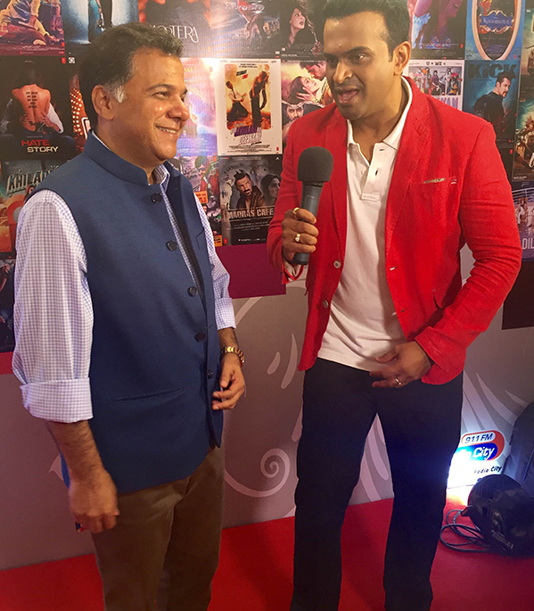 Sid K wearing Red Jacket with Raj Nayak